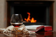 Cognac by the fireplace Stock Photography