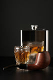 Cognac, flask and pipe Stock Image
