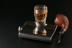 Cognac, flask and pipe Royalty Free Stock Photography