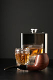 Cognac, flask and pipe Stock Photography