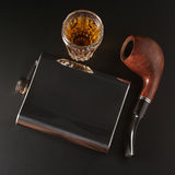 Cognac, flask and pipe Royalty Free Stock Photo