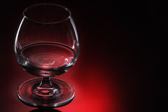 Cognac glass. On red background royalty free stock images