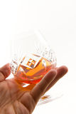 Cognac on the glass Stock Photo