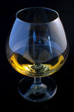 Cognac glass. A glass of congac isloated against black background stock photos
