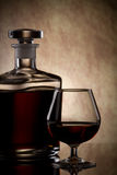 Cognac glass and bottle Stock Image