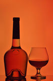Cognac glass and bottle Royalty Free Stock Images