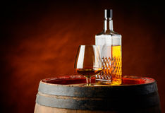 Cognac glass and bottle Stock Images