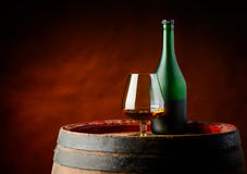 Cognac glass and bottle Stock Photos