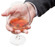 Cognac glass in businessman hand Stock Images