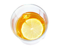 Cognac in a glass, with lemon Royalty Free Stock Images