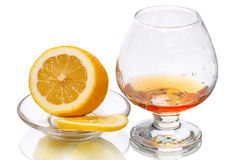 Cognac  glass and Lemon Stock Photos