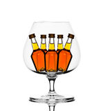 Cognac glass with little bottles inside Stock Photo