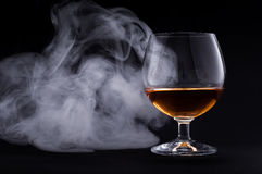 Cognac in glass stock image
