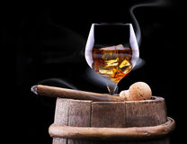 Cognac glass shrouded in a smoke Royalty Free Stock Photography