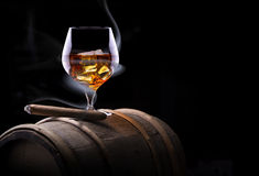 Cognac glass shrouded in a smoke Royalty Free Stock Image