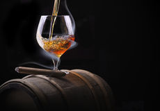 Cognac glass shrouded in a smoke Stock Photo