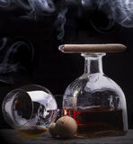 Cognac glass shrouded in a smoke Royalty Free Stock Photo