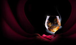 Cognac glass shrouded in a smoke Stock Photography