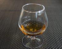 Cognac in glass themself Stock Photo