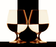 Cognac glasses. Sepia still life with two cognac glasses Royalty Free Stock Images