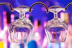 Cognac glasses on the bar hanger Stock Images