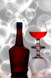 Cognac glasses and bottle Stock Photo
