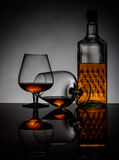 Cognac glasses and bottle Royalty Free Stock Image