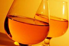 Cognac glasses with brandy Stock Images