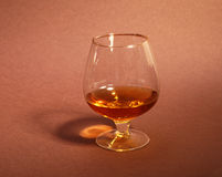 Cognac in a glasses, pralines on Old textile sacking Royalty Free Stock Photos