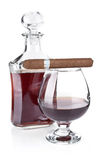 Cognac in goblet with cigar Stock Images