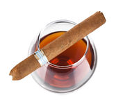 Cognac in goblet with cigar. On white background Royalty Free Stock Photo