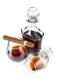 Cognac in goblet with cigar Royalty Free Stock Images