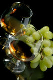 Cognac and grapes Stock Image
