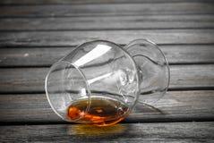 Cognac i ett exponeringsglas royaltyfri bild