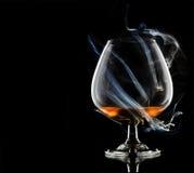 Cognac i rök royaltyfria foton