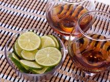 Cognac with lemon Royalty Free Stock Image