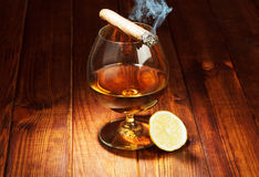 Cognac with lemon and cigar Royalty Free Stock Photography