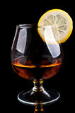 Cognac with lemon in a classic glass Stock Photography