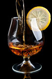 Cognac with lemon in a classic glass Stock Image