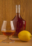 Cognac and lemon Stock Photography