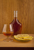 Cognac and lemon Royalty Free Stock Photography