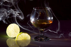Cognac with lime Royalty Free Stock Photography