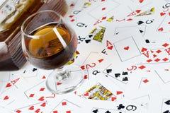 Cognac och leka kort Royaltyfria Bilder