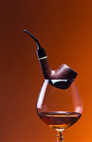 Cognac and pipe Stock Photos