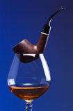 Cognac and pipe Royalty Free Stock Image
