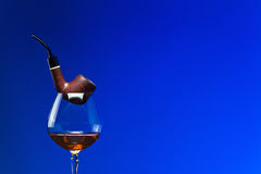 Cognac and pipe Royalty Free Stock Photography