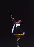 Cognac and pipe Stock Images