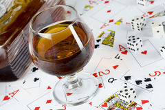 Cognac and playing card Stock Images