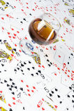 Cognac and playing card Royalty Free Stock Photos