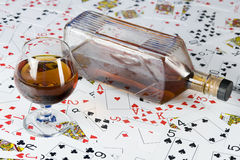 Cognac and playing card Royalty Free Stock Images